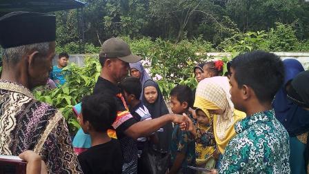 Basamo Kito Santuni Anak Yatim Desa Koto Perambahan