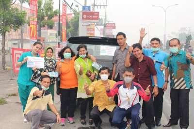Sebagai Bentuk Kepedulian ,PTPN V Bagi 10.000 Masker Di Pekanbaru